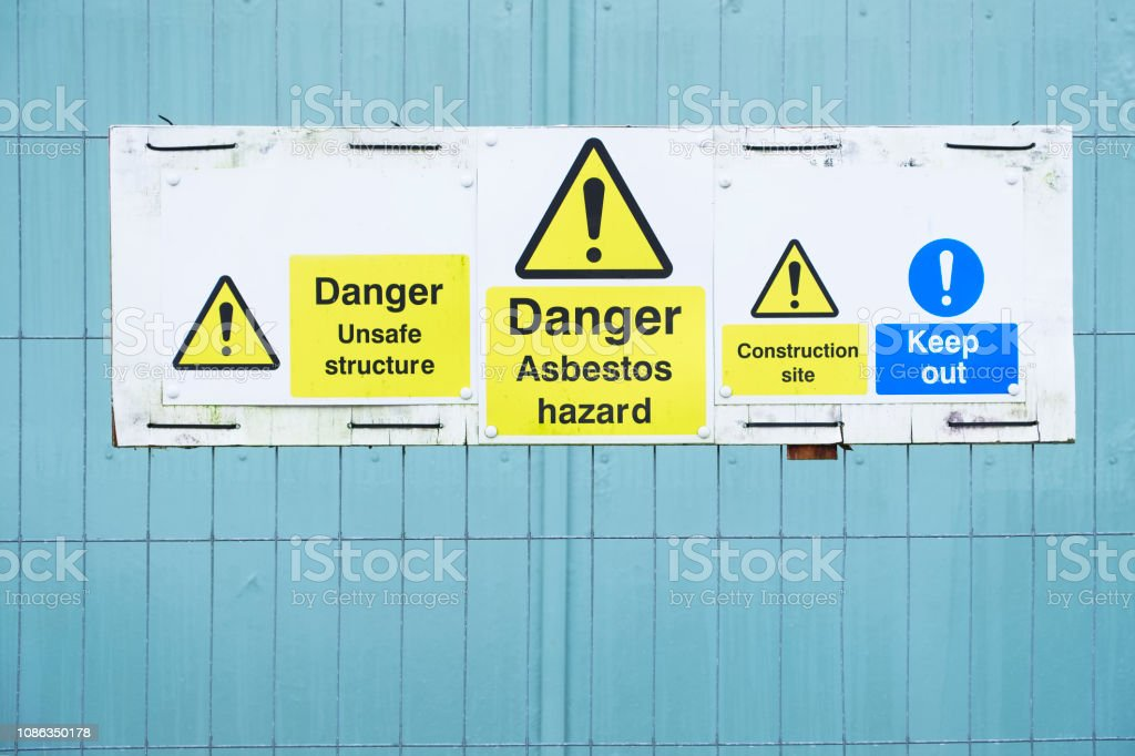 Asbestos hazard danger sign at construction site keep out stock photo