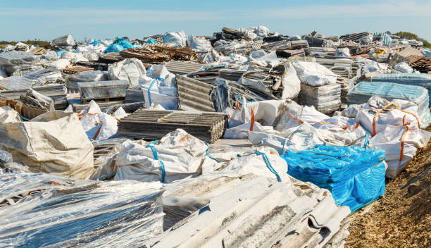 Asbestos landfill . Roof covering material with asbestos fibres . Asbestos roof removal . Dangerous asbestos dust and fibres in the environment . Health problems stock photo