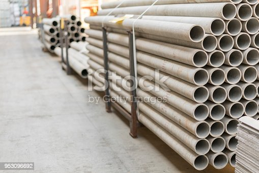 istock asbestos pipes in a stack in a warehouse or in a building store 953096692