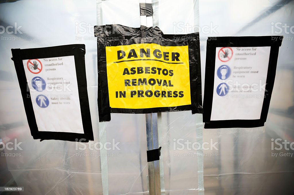 Asbestos removal signs on a plastic tent royalty-free stock photo