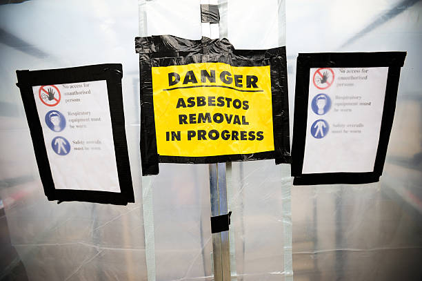 Asbestos removal signs on a plastic tent stock photo