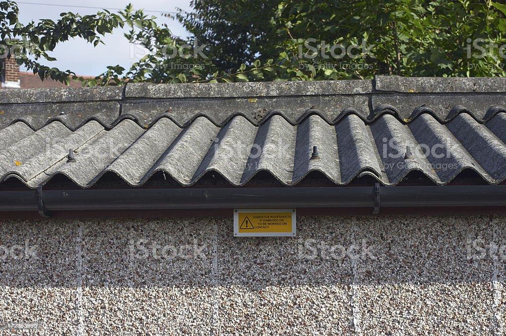 Asbestos roof and warning sign royalty-free stock photo
