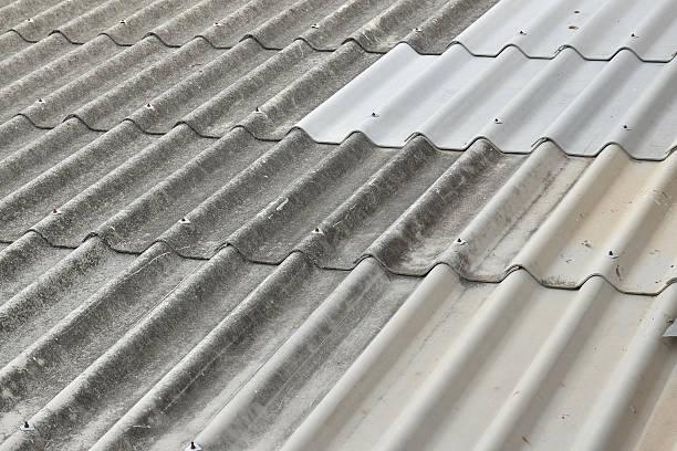 asbestos roof in background - dachschräge einrichten stock-fotos und bilder