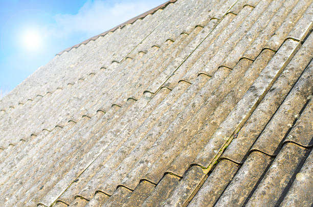 Asbestos roof with blue sky stock photo