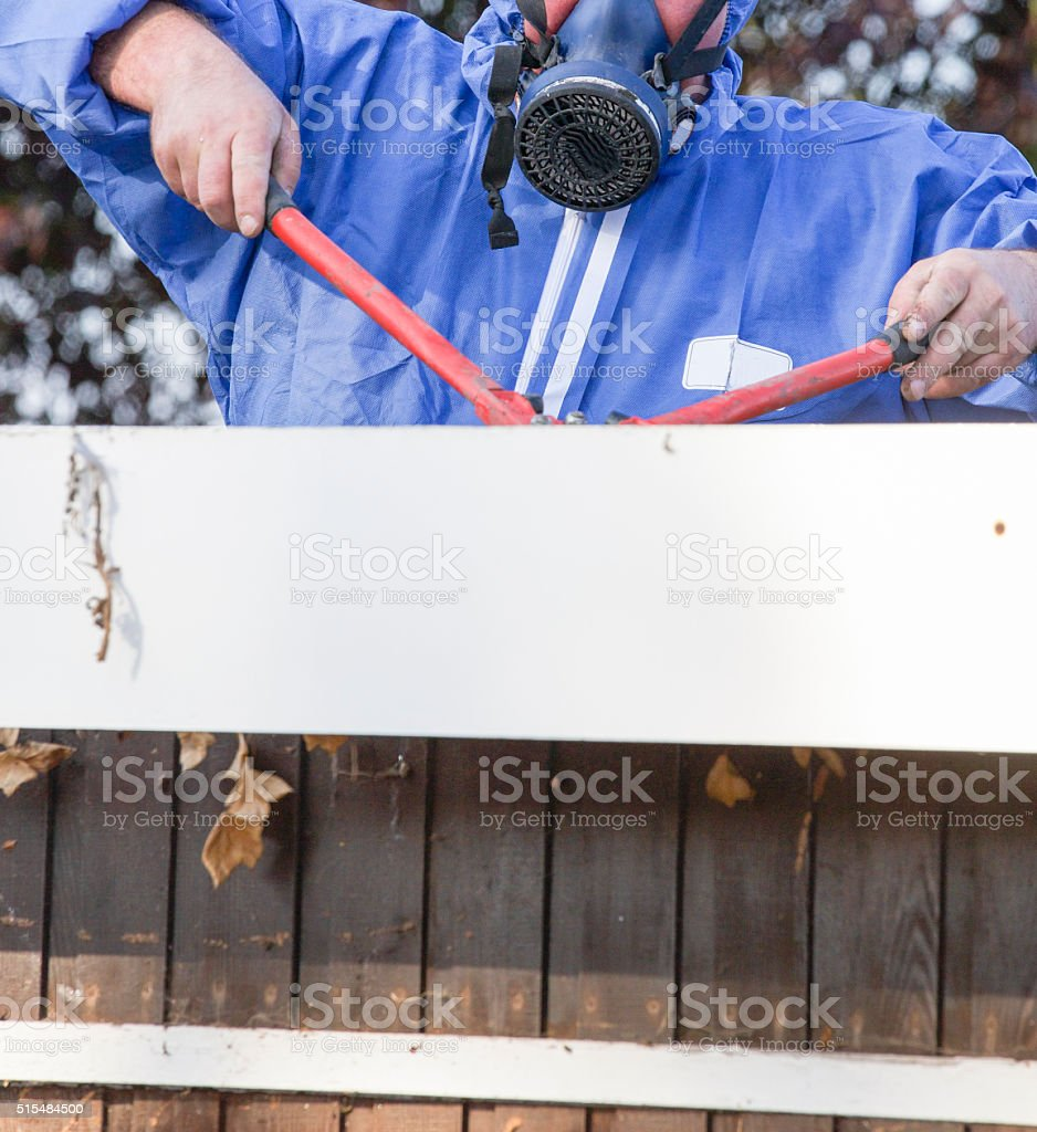 Asbestos roofing sheet being removed from garage demolish old structure stock photo