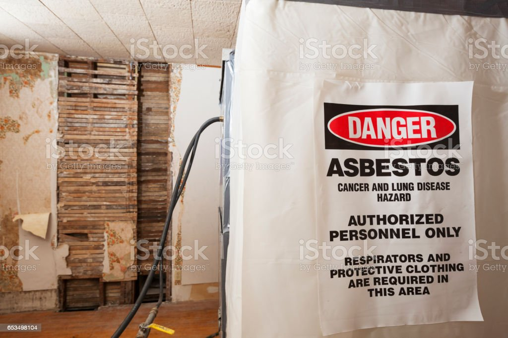 Asbestos Warning Danger Sign on a Decontamination Chamber stock photo