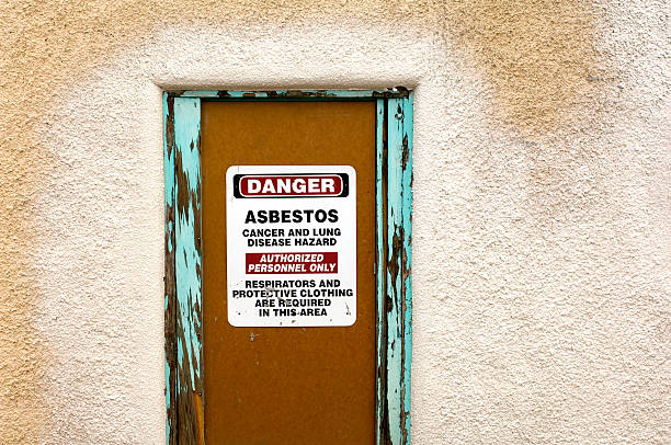 Asbestos Warning Sign on Condemned Property Door stock photo