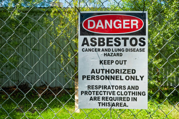 asbestos warning sign - under construction icon foto e immagini stock