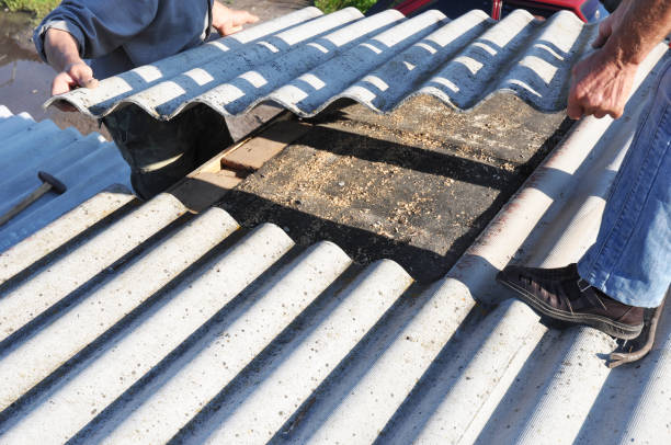 Asbestos workers repair asbestos roof. Asbestos removal. Asbestos workers repair asbestos roof. Asbestos removal. replacement stock pictures, royalty-free photos & images