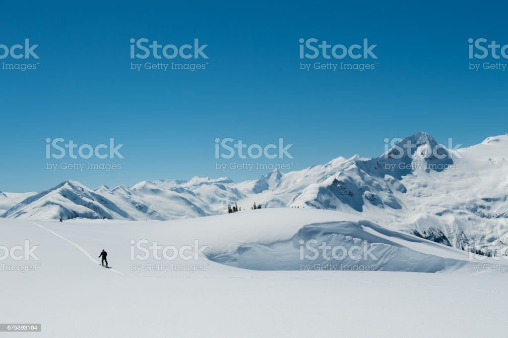 Ascending alpine mountain terrain stock photo