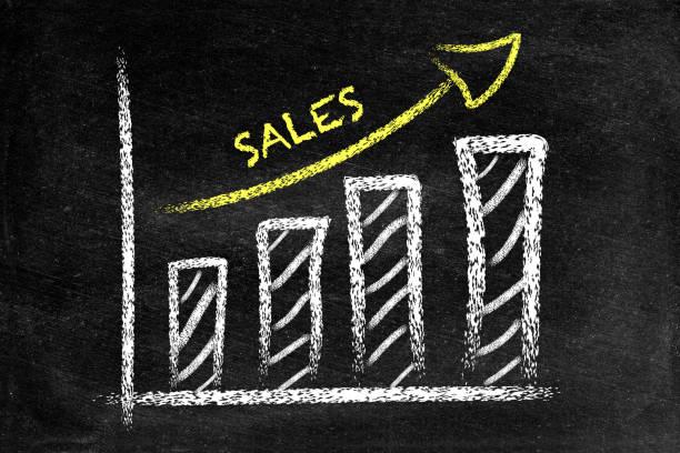 Ascending sales graph on blackboard stock photo