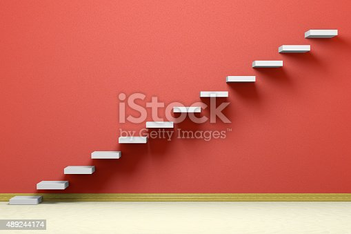 istock Ascending stairs in red empty room 489244174