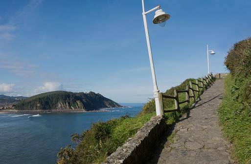 Ascent to the hermitage Virgen de la Guia, Punta del Caballo, Ribadesella, Asturias.
