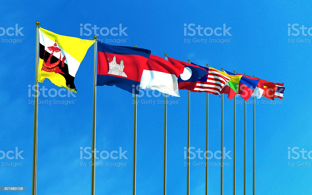 Asean Economic Community flags on the blue sky background. stock photo