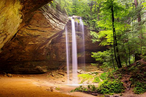 ash cave with waterfalls in hocking hills - hill stock pictures, royalty-free photos & images