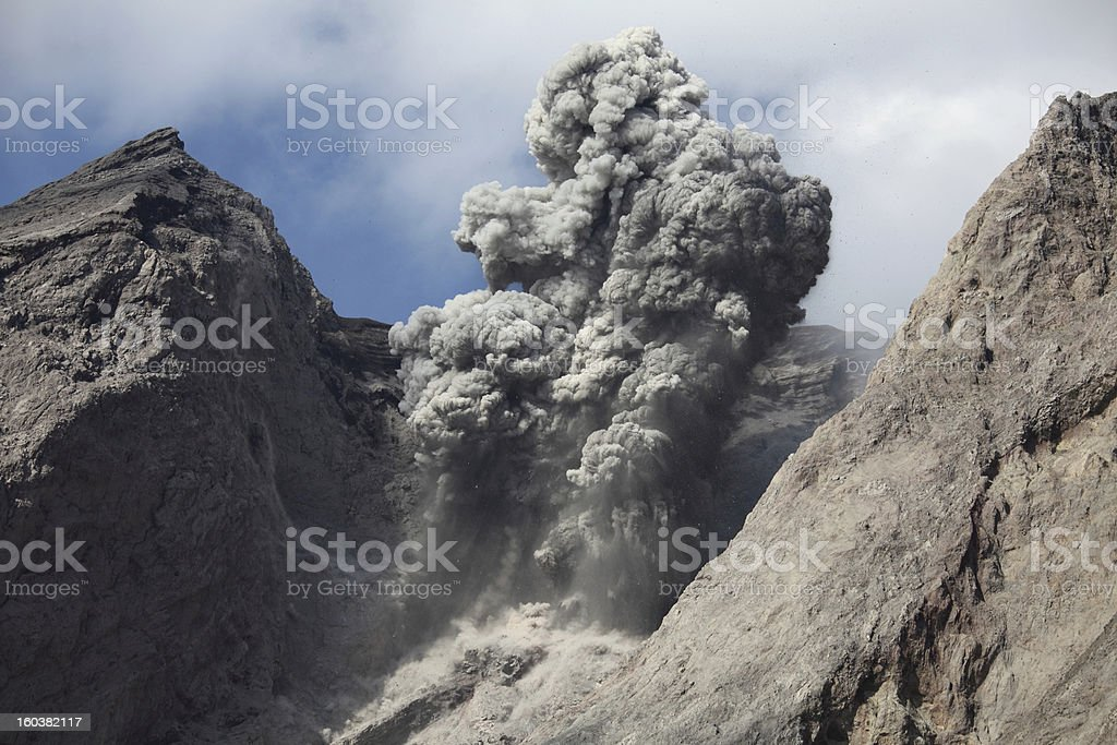 Ash cloud containing volcanic bombs, Batu Tara volcano. stock photo