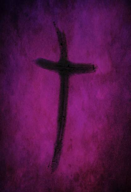 Ash cross drawn with finger on purple lenten backdrop Ash cross made from burned palm crosses isolated on purple and black speckled background. Ash Wednesday, repentance and hope in Christ concept. lent stock pictures, royalty-free photos & images