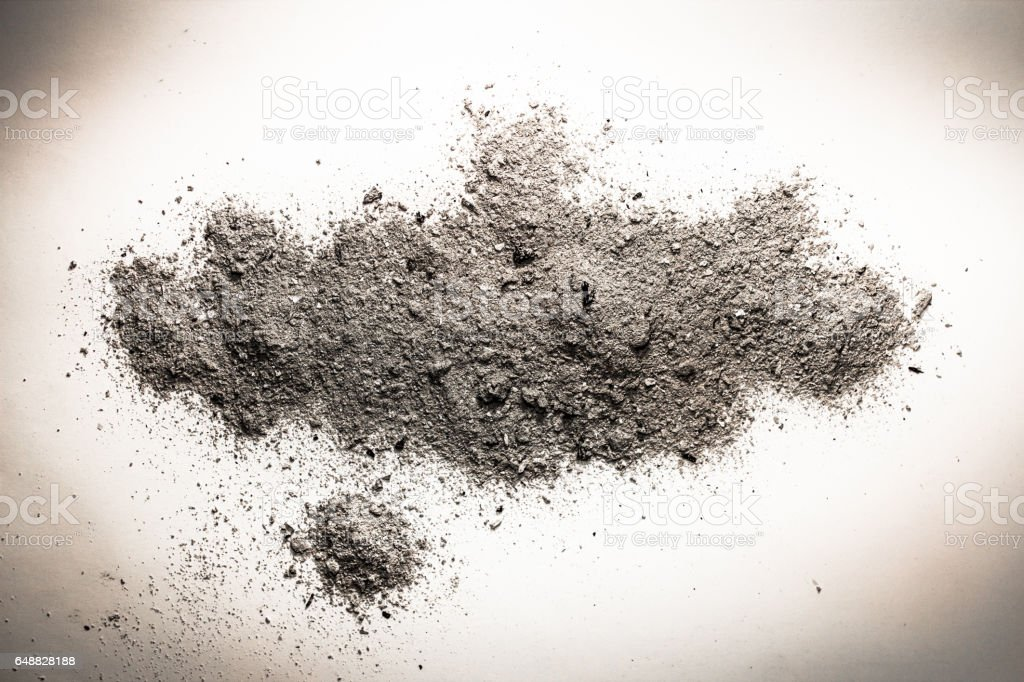 Ash, dust, sand or dirt on a pile as death, cremation remains, grey burnt trash concept stock photo