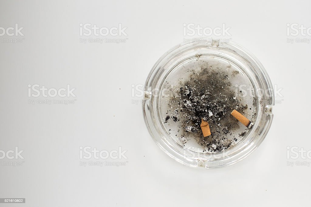 Ash tray with cigarette butts stock photo