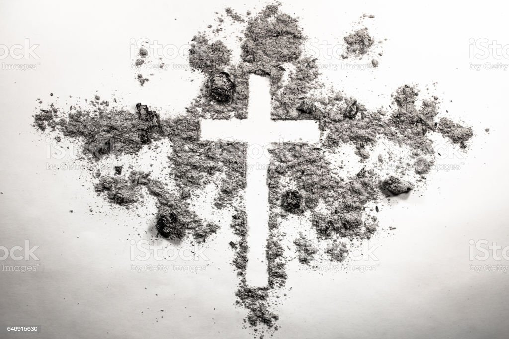 Ash wednesday cross, crucifix made of ash stock photo