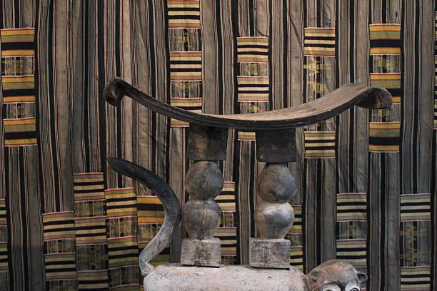 ashanti stool & kente weaving - kente cloth stock photos and pictures