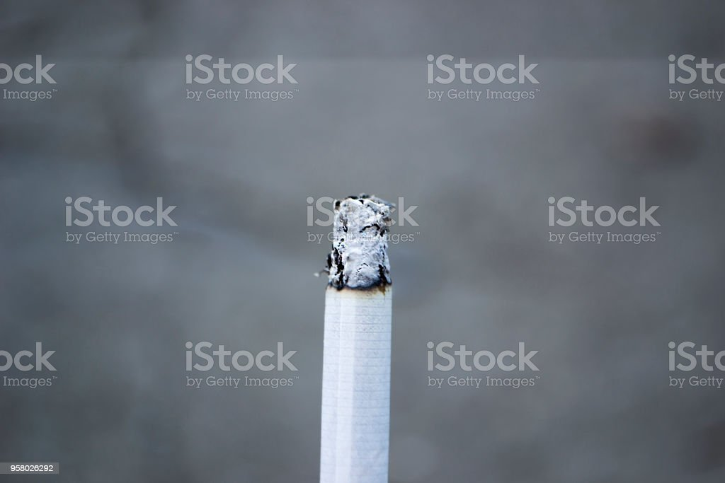 Ashes and smoke from a cigarette. stock photo