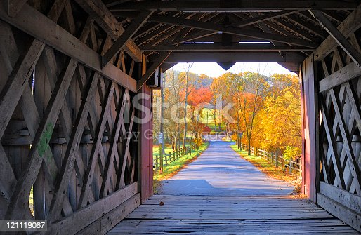 View from inside the Ashland covered bridge in Yorklyn, New Castle County, Delaware during the fall with colorful foliage in bright sunlight