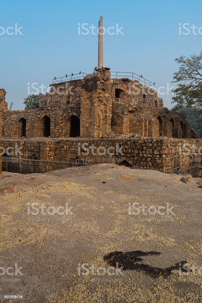 Ashoka pillar on pyramidal structure in Feroz Shah Kotla stock photo