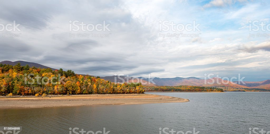 Ashokan Reservoir with Fall Colors and Dramatic Sky Catskills stock photo