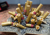 istock Ashtray and cigarette butts. Close-up, selective focus. 1094045090