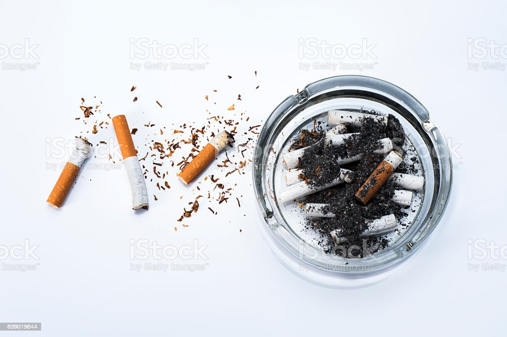 Ashtray and cigarette butts stock photo