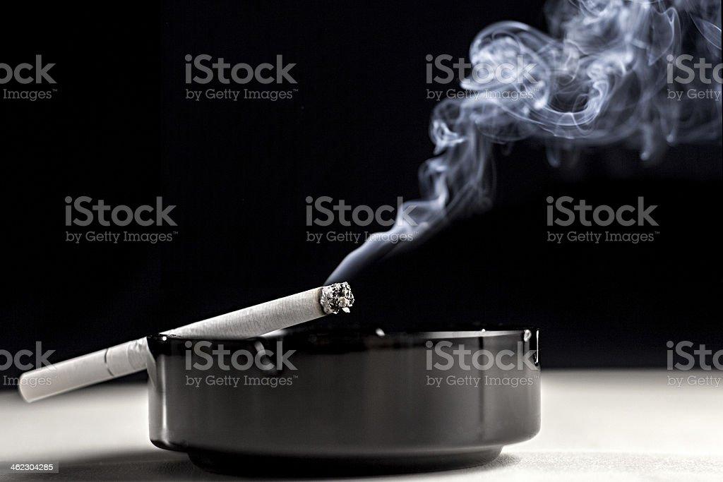 Ashtray cigarette and smoke stock photo