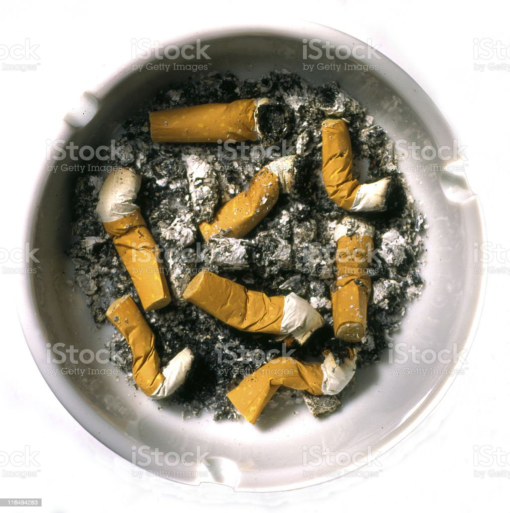Ashtray full of cigarettes stock photo
