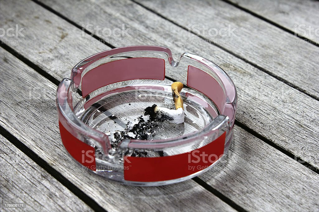 Ashtray in a beer garden royalty-free stock photo