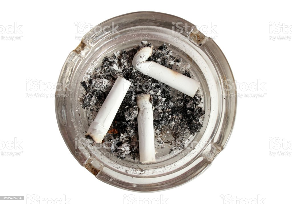 ashtray with burnt out cigarettes stock photo
