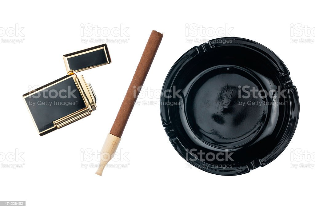 Ashtray with cigar and gold cigarette lighter stock photo