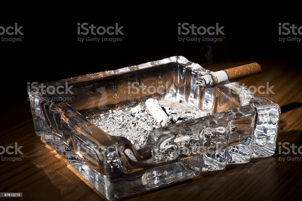 Ashtray with Cigarette on Wood royalty-free stock photo