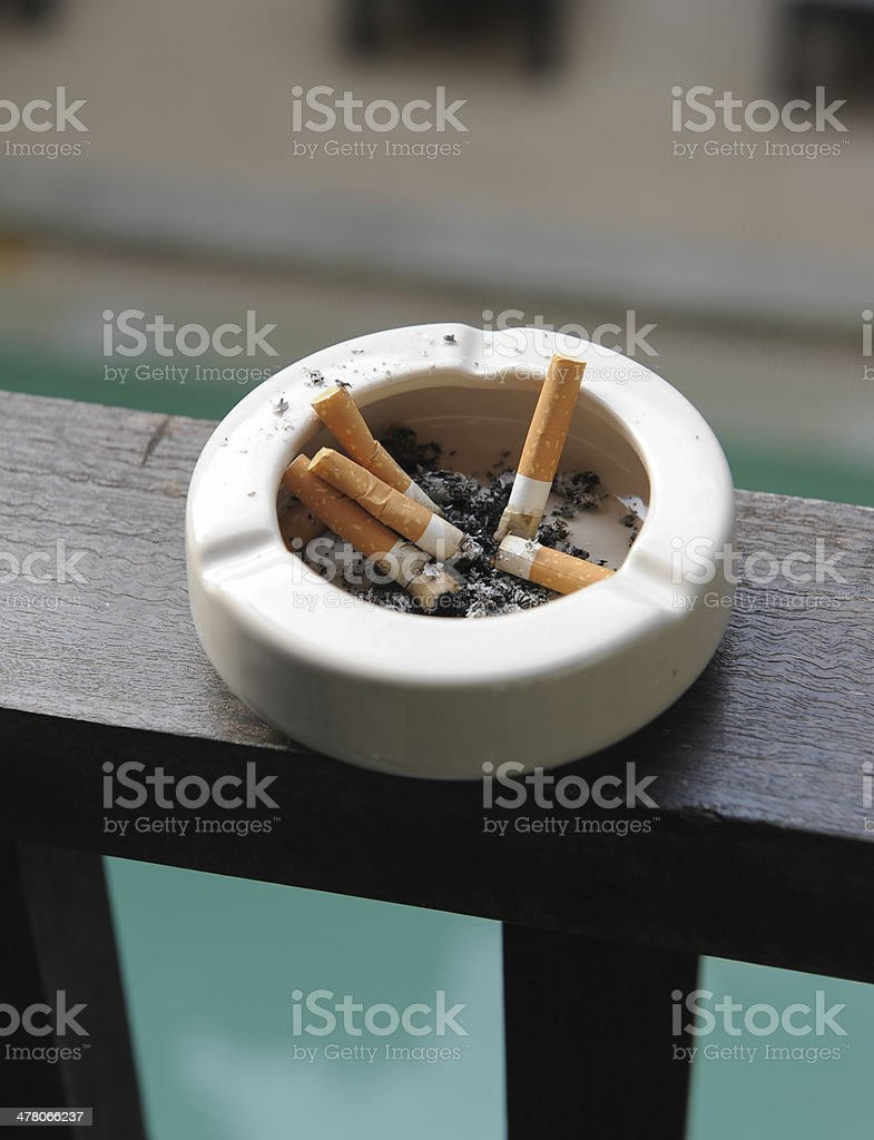 Ashtray with cigarettes and tobacco royalty-free stock photo