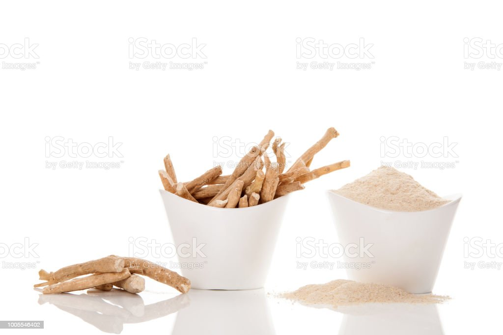 Ashwagandha powder and roots. stock photo