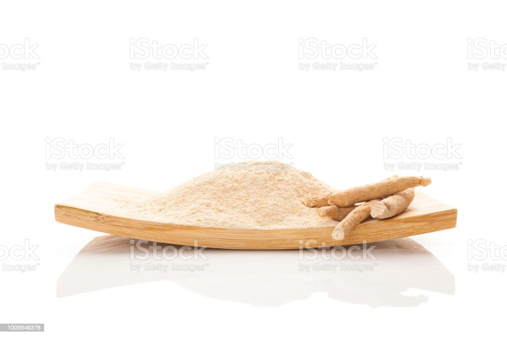 Ashwagandha powder with roots. stock photo
