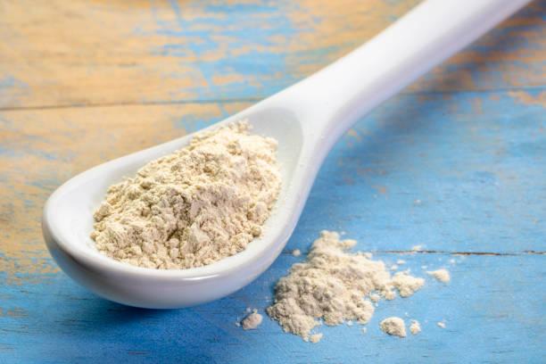 ashwagandha root powder on teaspoon stock photo