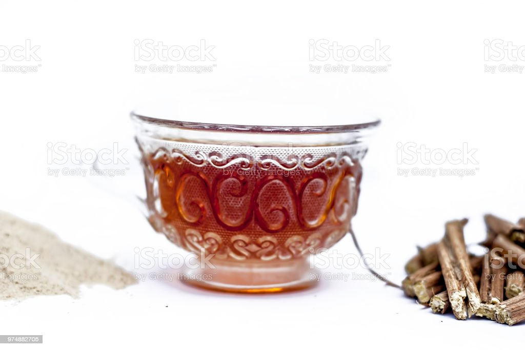 Ashwagandha roots and its powder also known as Indian ginseng, isolated on white essential beneficial for hair loss with its organic tea made from its powder. stock photo