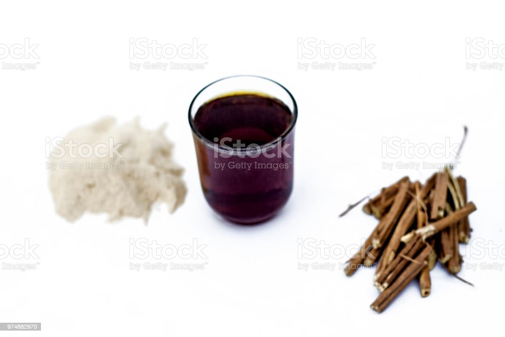 Ashwagandha roots and its powder also known as Indian ginseng, isolated on white essential beneficial for hair loss with its organic extract made from its powder. stock photo