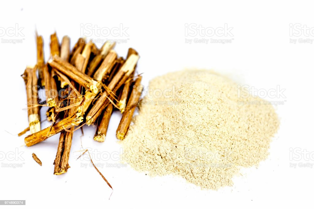 Ashwagandha roots and its powder also known as Indian ginseng, isolated on white essential beneficial for hair loss, stock photo