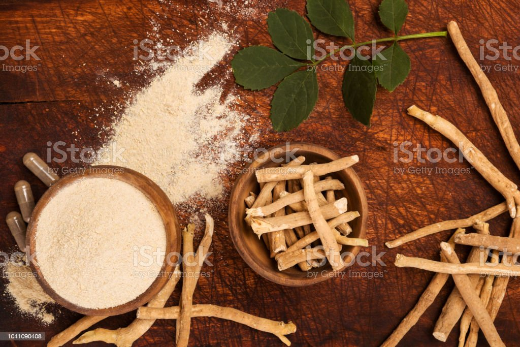 Ashwagandha superfood powder and root. stock photo