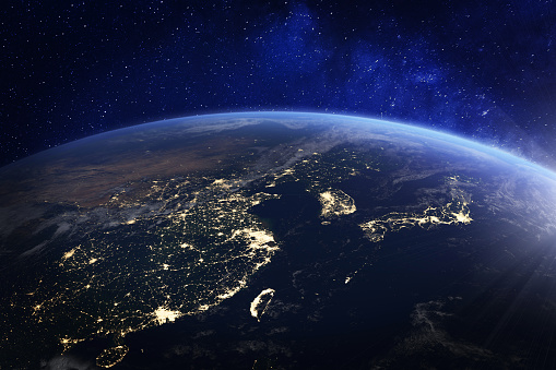 989624498 istock photo Asia at night from space with city lights showing human activity in China, Japan, South Korea, Hong Kong, Taiwan and other countries, 3d rendering of planet Earth, elements from NASA 1041176610