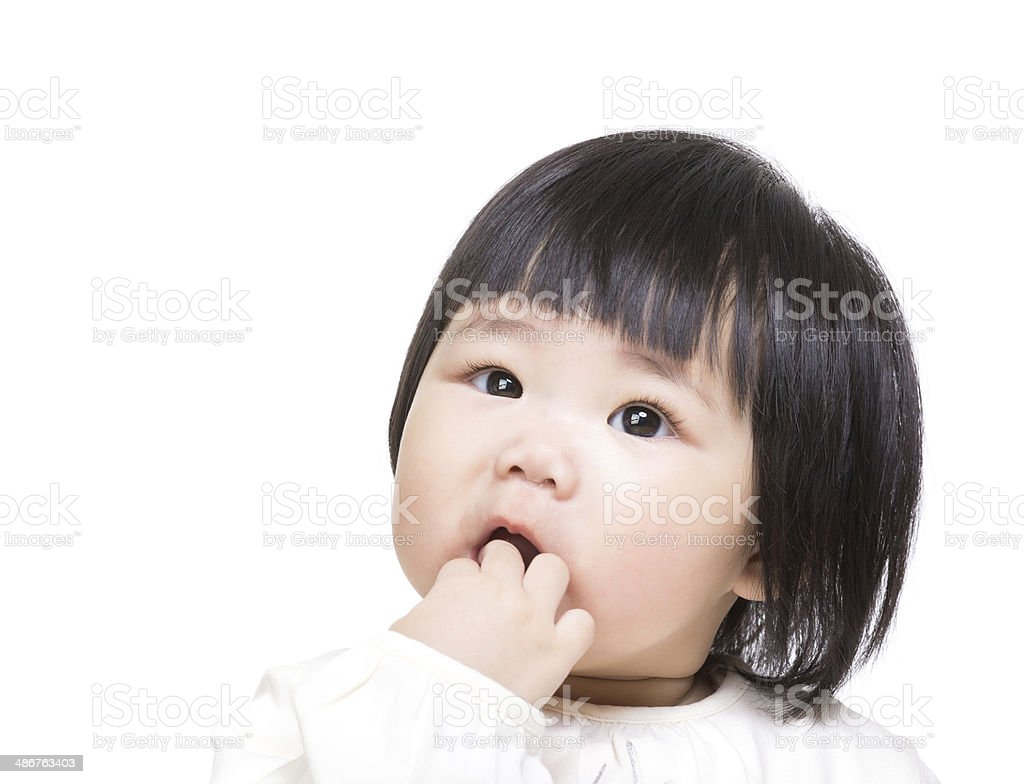 Asia baby suck finger in mouth stock photo