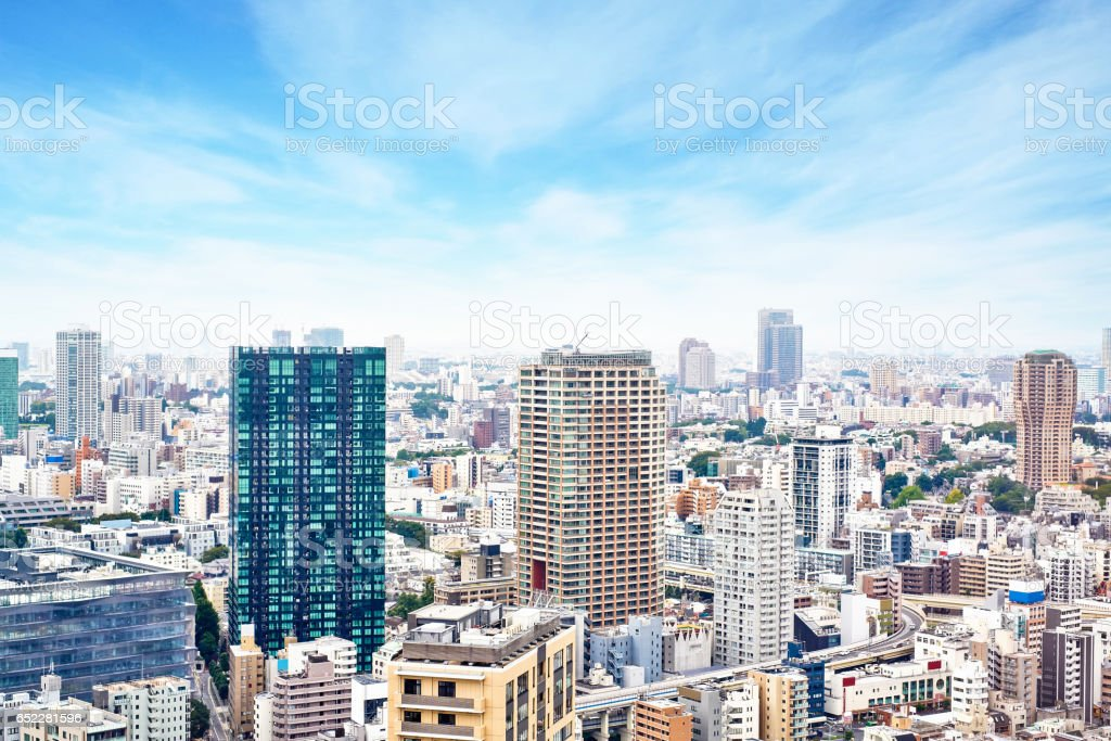 Asia Business concept for real estate and corporate construction - modern cityscape building bird eye aerial view from tokyo tower under sunrise and morning blue bright sky in Tokyo, Japan stock photo