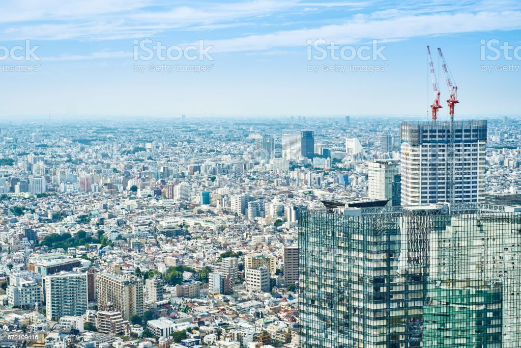Asia Business concept for real estate and corporate construction - panoramic modern cityscape building bird eye aerial view under sunrise and morning blue bright sky in Tokyo, Japan stock photo