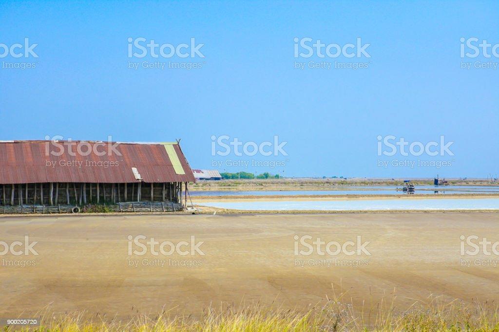 Sea salt farm with Three roller cars at Banlam Phetchaburi Thailand